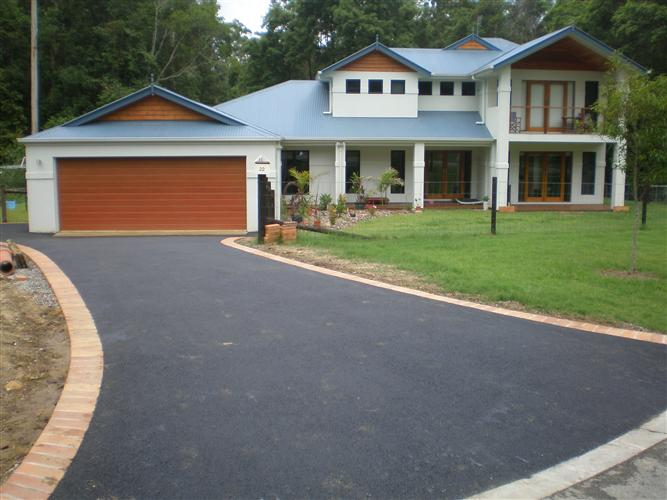 how to use pebbles on a concrete driveways